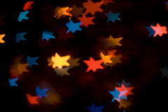 Colorful bokeh star lights Stock Image