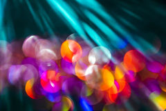 Colorful Bokeh with Sun Rays. Glitter abstract background with bokeh defocused with natural sun rays royalty free stock photos