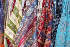 Colorful bolts of fabric. Multiple bolts of colorful patterned fabrics Stock Image