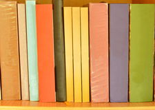 Colorful book arrange on wooden shelf Stock Photography