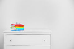 Colorful book on console white table.Cup coffee on colorful book in living room . Stock Image