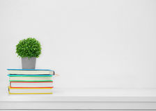 Colorful book on console white table on white background.Backgro Royalty Free Stock Photo