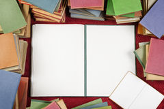 Colorful books with blank one opened in the middle Royalty Free Stock Photo