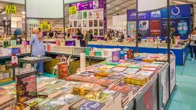Colorful books displayed on stands in a book fair in Eskisehir, Turkey royalty free stock photo