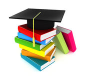 Colorful books and graduation cap Stock Photos