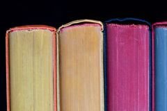 Colorful books. hard cover. Black background. Isolated Royalty Free Stock Images