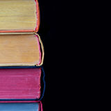 Colorful books. hard cover texture. Black background. Isolated Royalty Free Stock Images