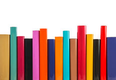 Colorful books in a row. Isolated on a white background Royalty Free Stock Image