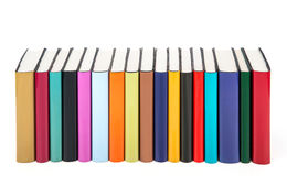 Colorful books in a row. Isolated on a white background royalty free stock photography