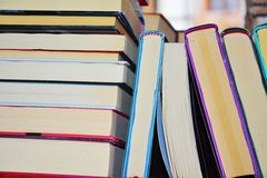 Colorful books on the shelf. Colorful books on a shelf, vertically and horizontally disposed, vintage and educational image Royalty Free Stock Image