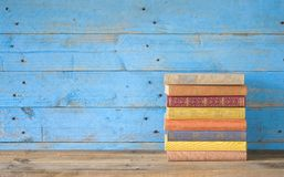 Colorful books. On a wooden shelf, free copy space Stock Images