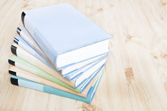 Colorful bookstack. On wooden floor Royalty Free Stock Photos