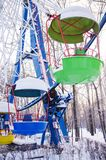 Colorful booths of ferris wheel under the snow. vertical. Colorful booths of ferris wheel under the snow closed for the winter. vertical Royalty Free Stock Image