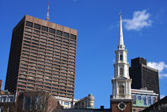 Colorful boston. Downtown Boston showing the clock tower and steeple of Park Street Church surrounded by more modern buildings Stock Images
