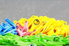 Colorful bottle openers on sale on the streets of Accra, Ghana. In green and pink and yellow and green royalty free stock image