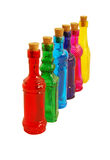Colorful Bottles. Bright colorful bottles lined up in a row Stock Photos