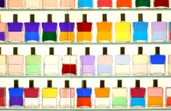 Colorful bottles. Display of colorful bottles on shelves Royalty Free Stock Image