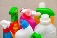 Colorful cleaning products in the bathroom stock photos
