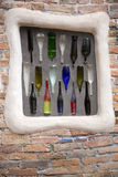 Colorful bottles embedded into brick wall Royalty Free Stock Photos