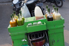 Colorful bottles of juices and sauces sold on the back of the motorbike, Java, Indonesia Royalty Free Stock Photography