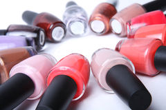 Colorful bottles of nail polish on white. Stock Photo