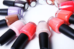 Colorful bottles of nail polish on white. Stock Photos