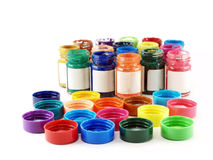 colorful of bottles poster color and caps Stock Photos