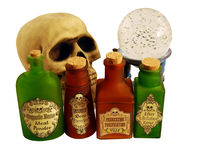 Colorful Bottles of potions. Bright colorful bottles of potions, Crystal ball for seeing into the future, and Skull with eye sockets and teeth Royalty Free Stock Images