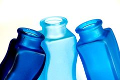Colorful bottles on white background. Three colorful bottles on white background Royalty Free Stock Image