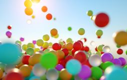 Colorful bouncing balls outdoors against blue sunny sky. Lots of colorful bouncing balls outdoors against blue sunny sky with chaotic motion - perfect party royalty free stock photo