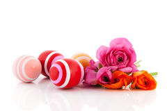 Colorful bouquet butter cups and easter eggs Stock Image