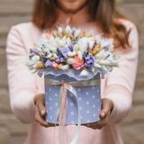 Colorful bouquet of different dried flowers deadwood flowers in the hands of florist woman. Rustic flower background. Colorful bouquet of different dried flowers royalty free stock images