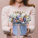 Colorful bouquet of different dried flowers deadwood flowers in the hands of florist woman. Rustic flower background. Colorful bouquet of different dried flowers stock images