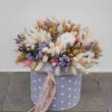Colorful bouquet of different dried flowers deadwood flowers in the hands of florist woman. Rustic flower background. Colorful bouquet of different dried flowers royalty free stock image
