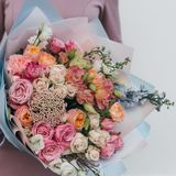 Colorful bouquet of different fresh flowers in the hands of florist woman. Rustic flower background. Craft bouquet of. Colorful bouquet of different fresh royalty free stock photography