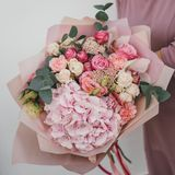 Colorful bouquet of different fresh flowers in the hands of florist woman. Rustic flower background. Craft bouquet of. Colorful bouquet of different fresh royalty free stock image