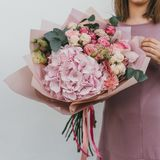 Colorful bouquet of different fresh flowers in the hands of florist woman. Rustic flower background. Craft bouquet of. Colorful bouquet of different fresh stock photography