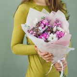 Colorful bouquet of different fresh flowers in the hands of florist woman. Rustic flower background. Craft bouquet of. Colorful bouquet of different fresh royalty free stock photo