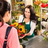 Colorful bouquet florist woman selling customer flower. Colorful bouquet florist women selling customer flower shop store Royalty Free Stock Images