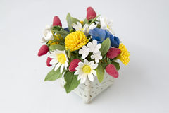Colorful bouquet of flowers and berries on a white Stock Images