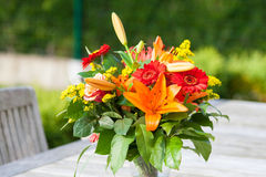 Colorful bouquet of flowers on the garden table. Stock Photos