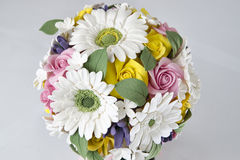 Colorful bouquet of flowers on a gray Stock Photography