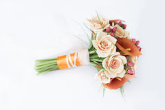 Colorful bouquet of orange calla lilies on a white Stock Photo