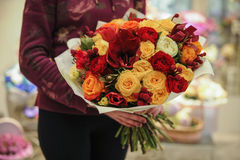 Colorful bouquet  with roses. flower composition. In hands Stock Image