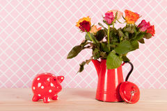 Colorful bouquet roses and piggy bank Royalty Free Stock Photos