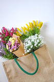 Colorful Bouquet in Shopping Bag Stock Images