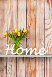 Colorful bouquet tulips at home Stock Images
