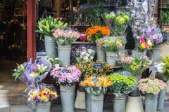 Colorful bouquets in front of flower shop, Paris, France. Bouquets and bunches of flowers displayed in metal buckets in front of flower shop, Paris, France stock images