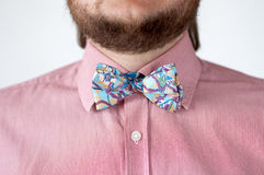 Colorful bow tie with pink shirt. Stock Photo