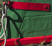 Colorful bow of a wooden fishing boat. Particularly colorful red and green bow of a wooden fishing boat Royalty Free Stock Photography